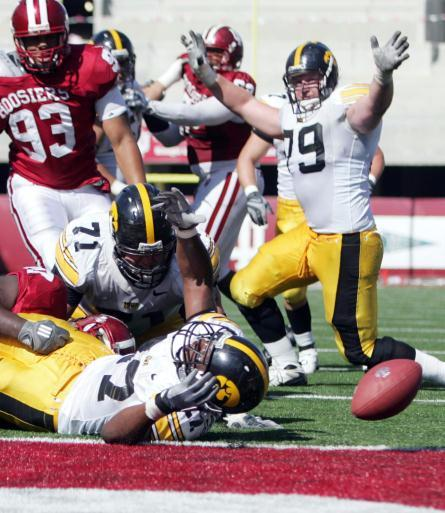Caption: Iowa offensive lineman Bryan Bulaga (79, right) celebrates a touchdown by Jewel Hampton (27, bottom) during the fourth quarter of the Hawkeyes' 45-9 win over the Hoosiers at Memorial Stadium in Bloomington, Ind., on Saturday, Oct. 11, 2008.