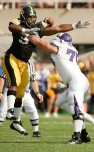 Iowa's Adrian Clayborn tries to block a Northwestern pass as he contends with Northwestern's Al Netter at Kinnick Stadium in Iowa City on Saturday, September 27, 2008. (Cliff Jette/The Gazette)