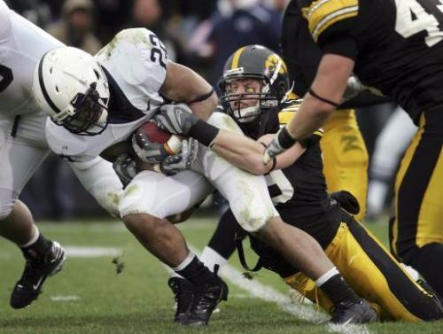 Caption: Iowa's A.J. Edds (49) wraps up Penn State's Evan Royster (22) during the second quarter of their game Saturday, Nov. 8, 2008 at Kinnick Stadium in Iowa City. Iowa won the game, 24-23.(Brian Ray/The Gazette)