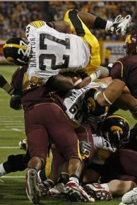 Iowa running back Jewel Hampton leaps over a Minnesota defender for a first down in Iowa's 55-0 victory last November.