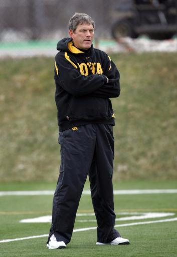 Iowa coach Kirk Ferentz watches his team workout during their practice Wednesday, March 25 at the Kenyon Football Practice Facility on the University of Iowa campus. (The Gazette, Brian Ray)