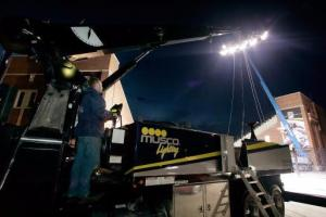 MUSCO lighting technician Greg Soy of Muscatine raises one of the company's mobile light towers on September 28, 2006 as the MUSCO crew prepared for the Iowa vs. Ohio State Football game at Kinnick Stadium. (Brian Ray/Gazette)