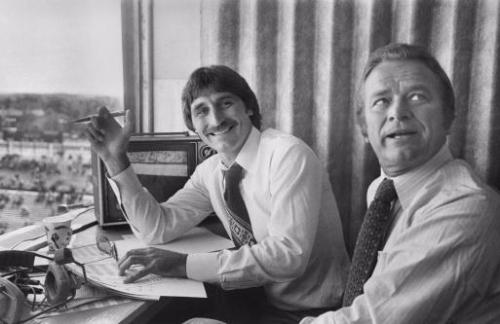 Iowa football radio color commentator Ed Podolak (left) has been in the Iowa radio booth for 28 years. He's shown here with Jim Simpson, longtime NBC and ESPN sportscaster. (Gazette file)