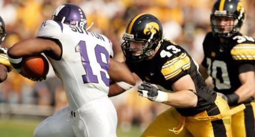 Northwestern's Tyrell Sutton is tackled by Pat Angerer of Iowa at Kinnick Stadium in Iowa City on Saturday, September 27, 2008. (Cliff Jette/The Gazette)