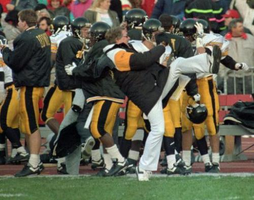 Hayden Fry kicks up a heel after the Hawkeyes scored a TD at Ohio State in 1991. (Gazette file)