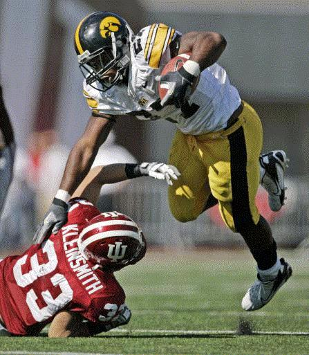 Iowa running back Jewel Hampton (27, top) is upended by Indiana's Joe Kleinsmith (33) during the fourth quarter of the Hawkeyes' 45-9 win over the Hoosiers at Memorial Stadium in Bloomington, Ind., on Saturday, Oct. 11, 2008. (Gazette file)