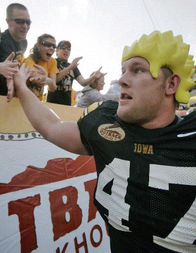 Iowa's Mitch King high-fives Hawkeye fans after the Hawkeyes beat the South Carolina Gamecocks in the Outback Bowl at Raymond James Stadium on Thursday, Jan. 1, 2009, in Tampa, Fla. Iowa won, 31-10. (Jim Slosiarek/The Gazette)