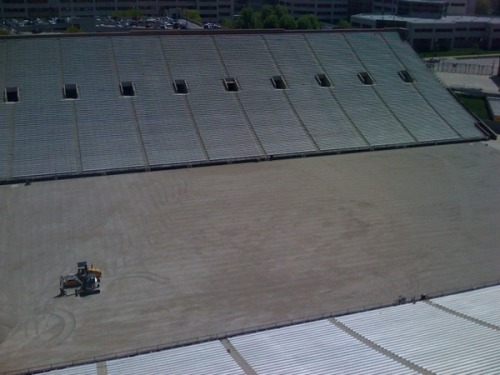 This is Kinnick Stadium at 12:15 p.m. on Friday. The UI is in the process of putting FieldTurf down and fixing the drainage system at Kinnick. The Hawkeyes open the season at Kinnick against Northern Iowa on Sept. 5. (Photo courtesy of Michael Graham).