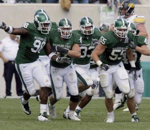Michigan State players celebrate with Adam Decker (55), who made the game saving tackle against Shonn Greene for Iowa during final minutes of the fourth quarter. The Spartans defeated the Hawkeyes 16-13, at Spartan Stadium in East Lansing, Michigan, Saturday, October 4, 2008. (Kirthmon F. Dozier/Detroit Free Press/MCT)