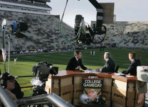 ESPN College Gameday hosts Chris Fowler (from left), Lee Corso, and Kirk Herbstreit talk while preparing to go on the air before the University of Iowa versus Ohio State football game at Kinnick Stadium in Iowa City Saturday, September 30, 2006. This was the last meeting between the two schools. The series picks up Nov. 14 in Columbus. (Gazette file)
