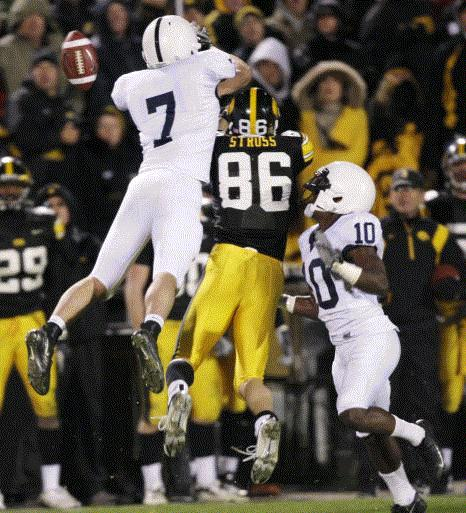 Iowa receiver Trey Stross (86) looks to make a reception between Penn State's Anthony Scirrotto (7) and Lydell Sargeant (10) during the second half of a NCAA college football game Nov. 8, 2008, in Iowa City. Scirrotto was called for pass interference on this play and it keyed Iowa's game-winning drive in a 24-23 victory. (Gazette file)