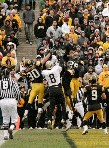 A mob of Iowa and Purdue plays leap for a last second Purdue pass into the endzone at the end of the fourth quarter at Kinnick Stadium in Cedar Rapids on Saturday, November 15, 2008. The pass was incomplete and allowed the Hawkeyes to escape with a 22-17 victory. (Cliff Jette/The Gazette)