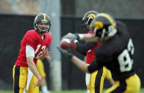 Quarterback Ricky Stanzi (12) hits receiver Steven Staggs (83) during their spring football practice on Saturday, April 18, 2009 in Iowa City, Iowa. (The Gazette, Brian Ray)