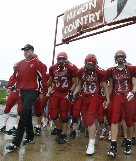 In this Friday, Sept. 5, 2008 file photo, Aplington-Parkersburg head coach Ed Thomas leads his team onto the field before their high school football game against West Marshall High School, in Parkersburg, Iowa. Aplington-Parkersburg High School officials sais Wednesday, June 24, 2009 that Thomas was shot in the school's weight room. (AP Photo/The Waterloo Courier,