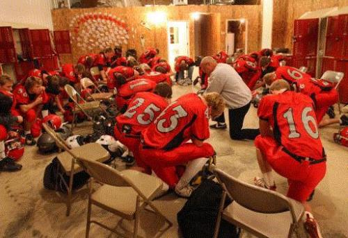 Aplington-Parkersburg Head Coach Ed Thomas prays with his team before their substate playoff game against St. Ansgar at Ed Thomas Field in Parkersburg, Iowa on Wednesday October 29, 2008. (Photo: Stephen Mally)