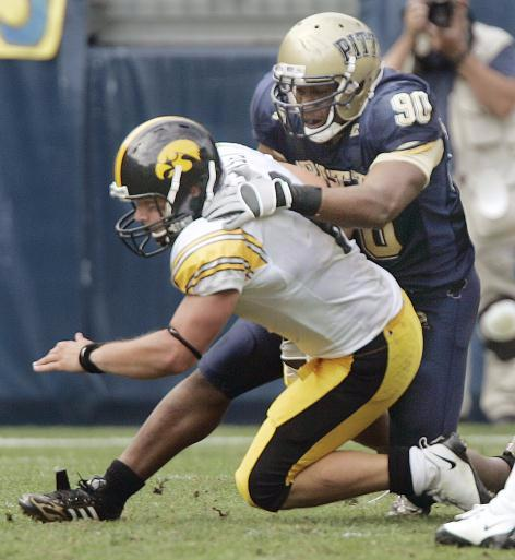 Pittsburgh defensive lineman Tony Tucker, right, sacks Iowa quarterback Jake Christensen, causing a fumble that Pittsburgh recovered with less than a minute to go in the fourth quarter of an NCAA college football game in Pittsburgh, Saturday, Sept. 20, 2008. The play was reviewed and the call of a fumble was upheld. Pitt held on to win 21-20.(AP Photo/Keith Srakocic)