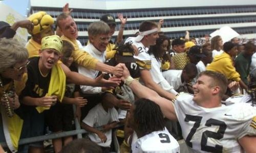 Iowa's Bruce Nelson (72) and Maurice Brown (9) celebrate with fans after defeating Penn State in overtime on Saturday, Sept. 28, 2002, Beaver Stadium in State College, Pa. (Gazette file)