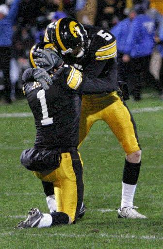 Iowa place kicker Daniel Murray (1) celebrates with holder Ryan Donahue (5) after making a 31-yard field goal to give Iowa the a one point lead over Penn State in the closing seconds quarter of their game Saturday, Nov. 8, 2008 at Kinnick Stadium in Iowa City. Iowa won the game by a score of 24 to 23.(Brian Ray/The Gazette)