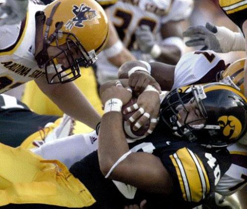 Arizona State's Brian Montesanto (97) wraps up Iowa's Edgar Cervantes (40) during the first quarter of Iowa's 21-2 victory Saturday September 20, 2003 at Kinnick Stadium. (Brian Ray/Gazette)