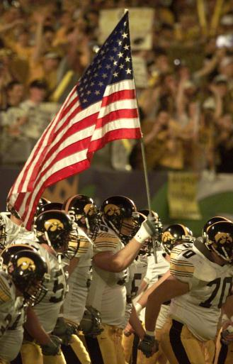 Robert Gallery carried the American flag while leading the Hawkeyes onto the field prior to the 2003 Orange Bowl in Miami. Gallery, now an Oakland Raider, did plenty of banner carrying for the Hawkeyes, winning the Outland Trophy in the 2003 season. (Gazette file)