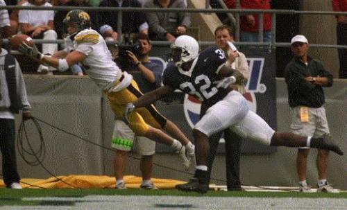 Iowa freshman Ed Hinkel makes a diving touchdown catch behind Penn State's Bryan Scott in Saturday's game at State College, Pa. The TD was the first of Hinkel's collegiate career. (Gazette file)