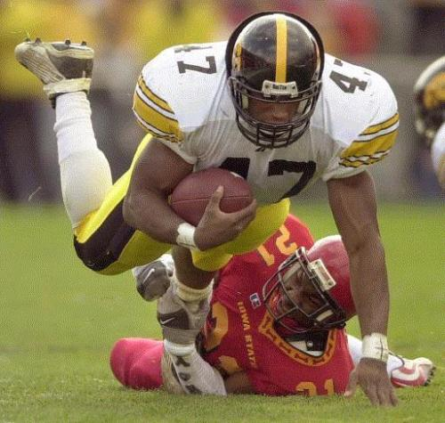 Iowa State's Atif Austin trips up Iowa's Jeremy Allen during the second quarter of their game Saturday, Nov. 24, 2001, at Jack Trice Stadium in Ames. Allen is the statistical anomaly of Iowa fullbacks during the Kirk Ferentz era. He was used more as an offensive weapon than a lead blocker. (Gazette/file)