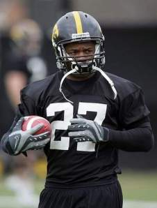 Iowa running back Jewel Hampton tucks the ball under his arm while working out during the team's practice March 25 at the Kenyon Football Practice Facility in Iowa City. Hampton sat out some of spring practice with a hamstring injury. Last Friday, he suffered a knee injury. (Brian Ray/The Gazette)