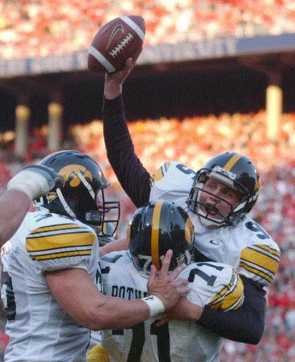 Iowa's Nate Kaeding (95) celebrates his fourth quarter touchdown against Ohio State with teammates Eric Rothwell (72) and Eric Jenson (35) Saturday, Oct. 18, 2003, in Columbus, Ohio. (AP Photo/Terry Gilliam)