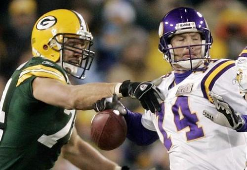 Green Bay Packers defensive end Aaron Kampman forces Minnesota Vikings quarterback Brad Johnson to fumble during the third quarter Monday, Nov. 21, 2005, in Green Bay, Wis. Packers' Kabeer Gbaja-Biamila recovered the fumble. (AP Photo/Morry Gash)