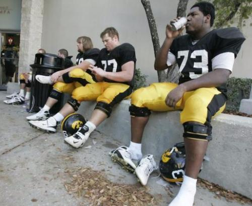 A group of young O-linemen cool off after a practice the week of the Outback Bowl in December 2008. (Jim Slosiarek/Gazette)