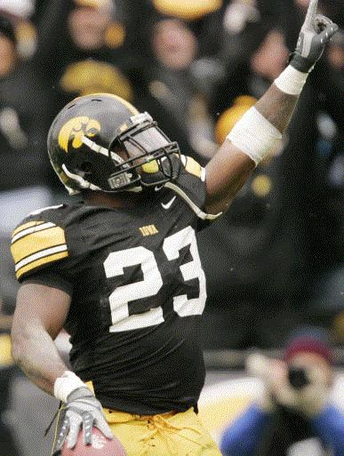Shonn Greene set Iowa season records for rushing yards (1,850) and rushing TDs (20) and led the Hawkeyes to a 9-4 record last season. Watching some teams try to tackle him was like watching someone trying to catch a piano falling down a flight of stairs. (Gazette/Cliff Jette)